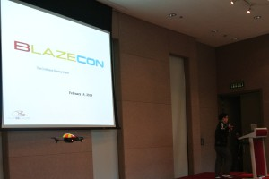 A drone hovers on stage as Outblaze CEO Yat Siu prepares to start the event